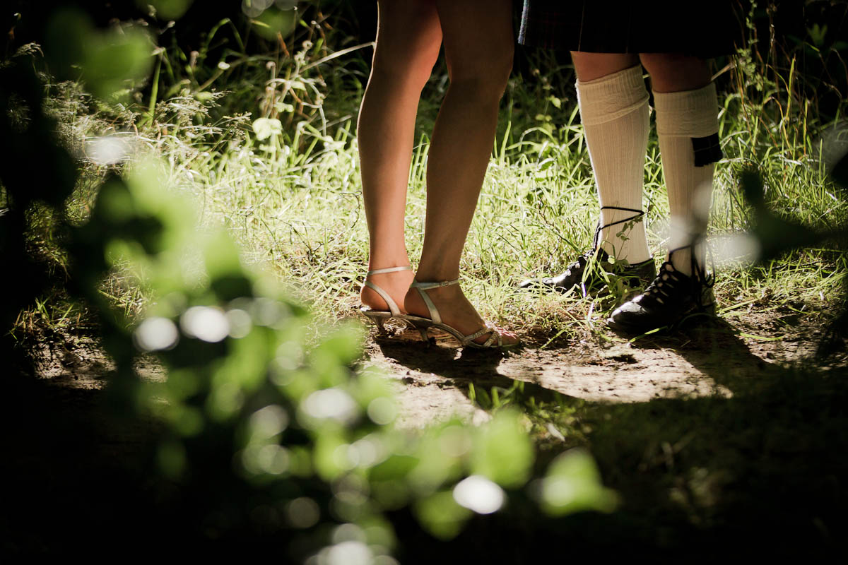 bride and groom legs outside