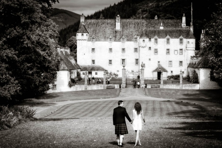 Bride and groom outside traquair house