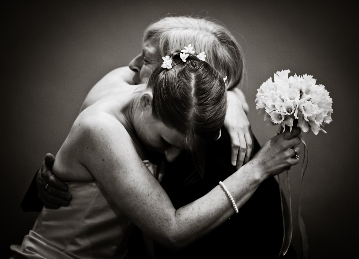 The lovely bride hugs her mother right before walking down the aisle.