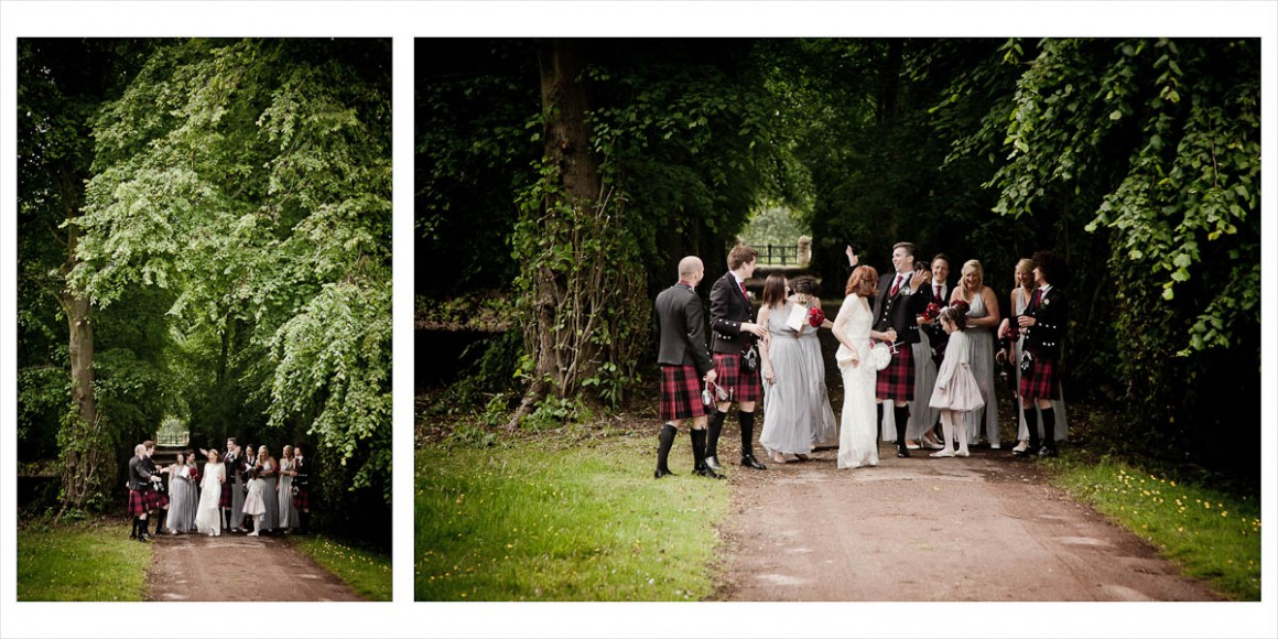 bride and groom walk in the woods with wedding party